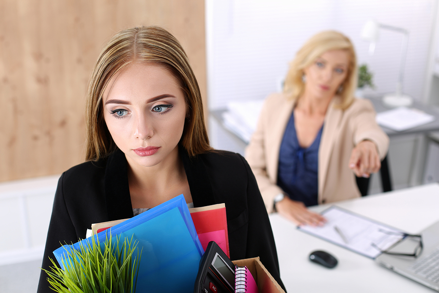 woman at work dealing with wrongful termination