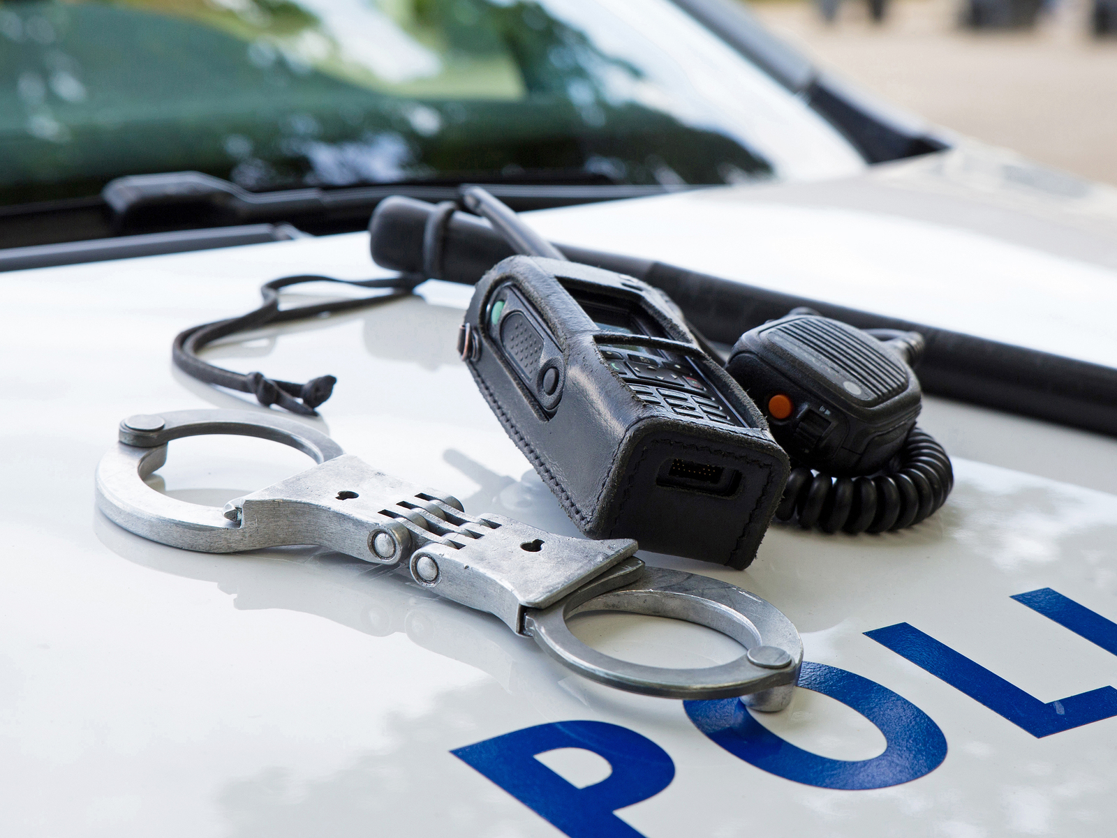 police car and handcuffs and radio