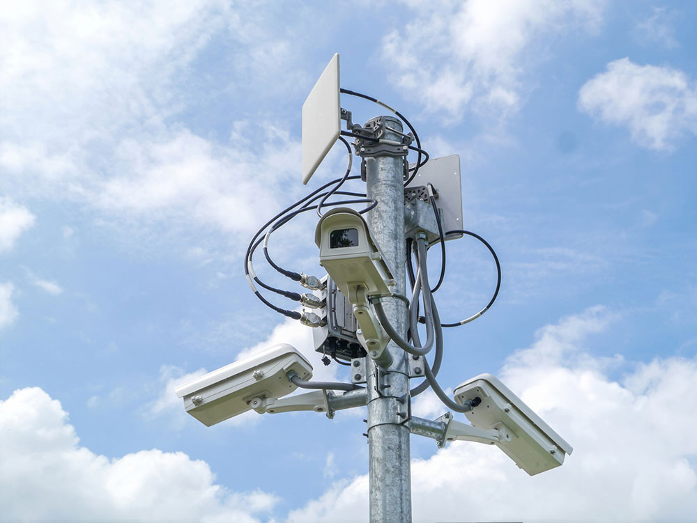 surveillance cameras on pole outside
