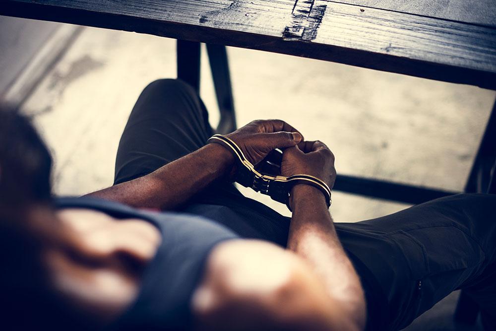 black man in handcuffs