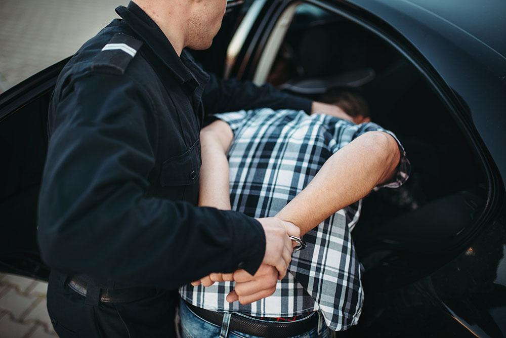 police officer arresting man