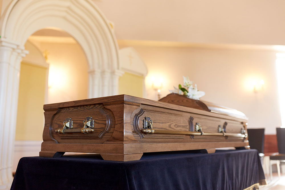 coffin at funeral, wrongful death