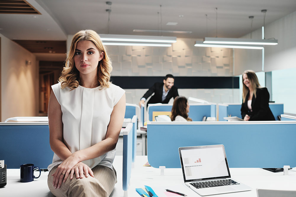 woman isolated at office, employee rights, sexist language