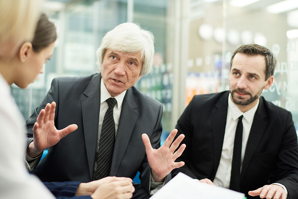senior man in meeting, age discrimination