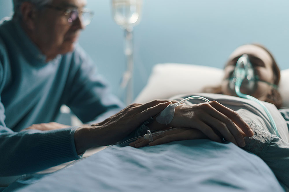 husband with wife at hospital, family fmla