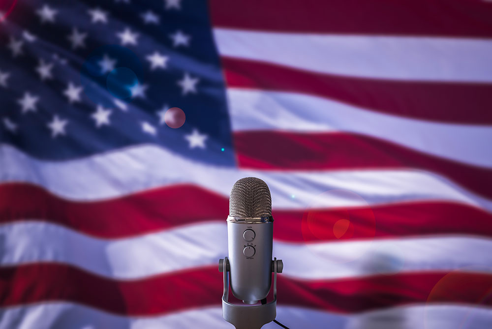 microphone in front of american flag, freedom of speech