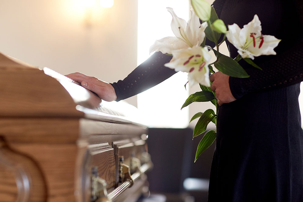 woman at funeral, wrongful death