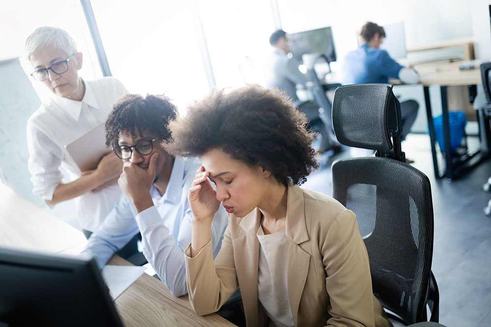 woman stressed at work, workplace discrimination